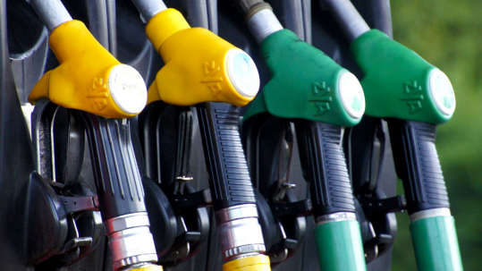 Gasoline and diesel pumps at a fuel station.