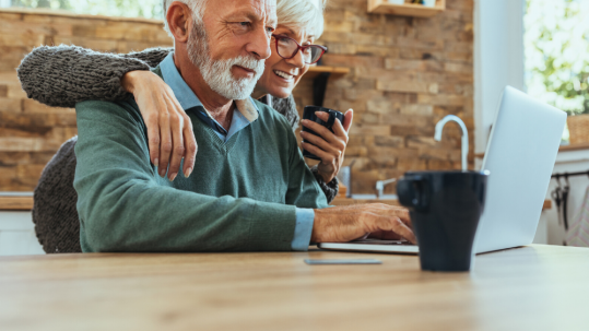 Senior Couple Looking at Computer Together